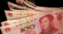 Foto LUSA: notas de 100 yuan ou Reminbi (RMB) . Pequim, China, 09 de fevereiro de  2011. EPA/HOW HWEE YOUNG
