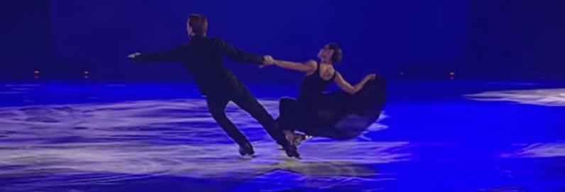 Par lituano dançando no gelo a música de um fado.